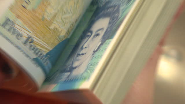 interior shots of new five pound plastic polymer banknotes on printing production line and stacks of newly printed notes on the 2nd june 2016 in... - currency symbol stock videos & royalty-free footage