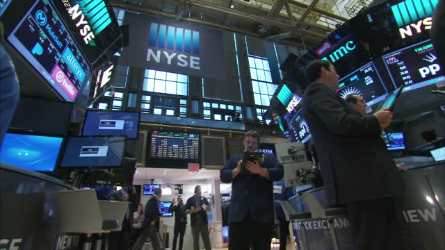 interior shots of new york stock exchange city traders looking at monitors featuring stock prices on the floor of the exchange on 20 april 2017 in... - stock trader stock videos and b-roll footage