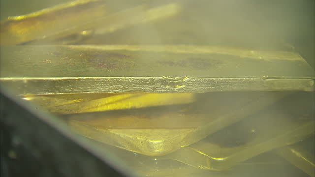vídeos de stock, filmes e b-roll de interior shots of newly cast gold ingots cooling after being dipped in water after smelting on may 12 2010 in beijing china - fornalha