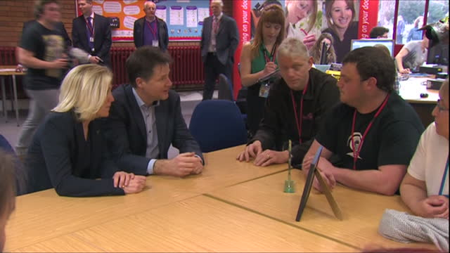 interior shots of nick clegg and tessa munt meeting with staff, apprentices and students at strode college.>> on march 16, 2015 in street, england. - british liberal democratic party stock videos & royalty-free footage