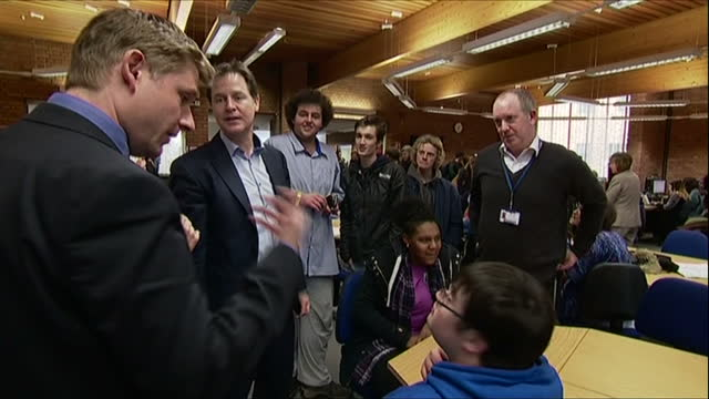 interior shots of nick clegg and tessa munt speaking to students at strode college and posing for 'selfie' mobile phone photos>> on march 16, 2015 in... - british liberal democratic party stock videos & royalty-free footage