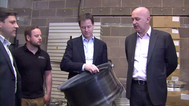 interior shots of nick clegg leader of the liberal democrats being shown round the dymagperformance racing wheels production workshop chatting to... - チッペナム点の映像素材/bロール