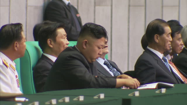 interior shots of north korean leader kim jong un sat with senior diplomats watching may day festival take place. north korea celebrates the 60th... - 外交点の映像素材/bロール