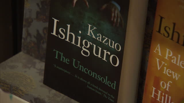 interior shots of novels by kazuo ishiguro on display in a waterstone's bookshop on october 05, 2017 in london, england. - kazuo ishiguro stock videos & royalty-free footage