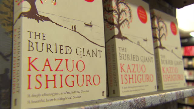 interior shots of novels by kazuo ishiguro on display in a waterstone's store including a sign announcing that tha author has been awarded the 2017... - nobel prize in literature stock videos & royalty-free footage