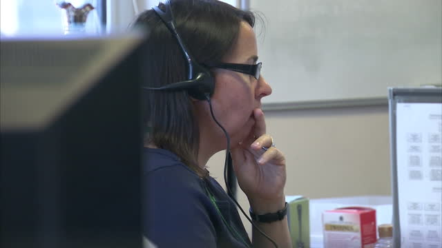 Interior shots of NSPCC call centre with workers on phones speaking to others and listening to people on the phones NSPCC Call centre gvs on August...