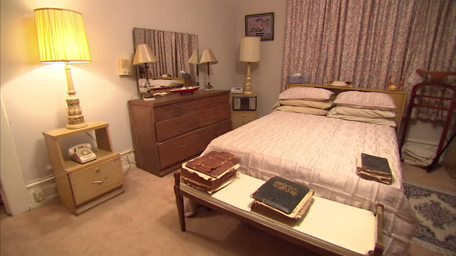 interior shots of one of the bedrooms in the jackson home museum including shots of a very worn bible at the foot of the bed and 1960's dial... - voting rights stock videos & royalty-free footage