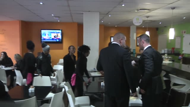 interior shots of oscar pistorius sitting in a coffee shop hugging people and holding his hands over his face in after his court hearng on june 13... - ピストリウス恋人射殺事件点の映像素材/bロール