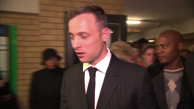 interior shots of oscar pistorius walking out of court on june 13 2016 in pretoria south africa paralympian oscar pistorius will face sentencing this... - オスカー・ピストリウス点の映像素材/bロール