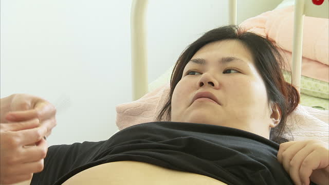 interior shots of overweight girls receiving acupuncture in bed on june 01 2014 in beijing china - acupuncture stock videos and b-roll footage