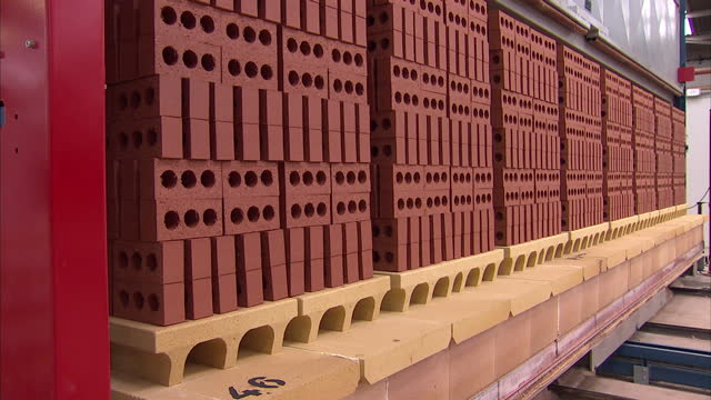 Interior shots of pallets of finished red bricks being moved out of a kiln along rails Bricks being manufactured in brickworks on November 07 2013 in...