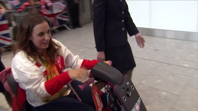 Interior shots of Paralympians arriving back from the Paralympic games in Rio including Lee Pearson Jodie Grinham Alison Patrick Hazel Smith Anne...