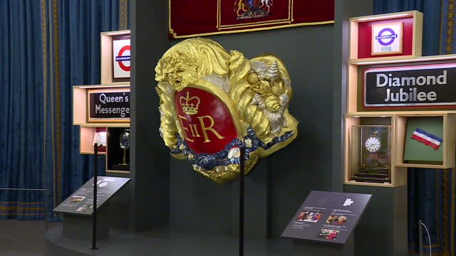 vídeos de stock, filmes e b-roll de interior shots of parts of the royal gifts exhibition at the buckingham palace state rooms including a gilded figurehead from the spirit of chartwell... - cortando fita
