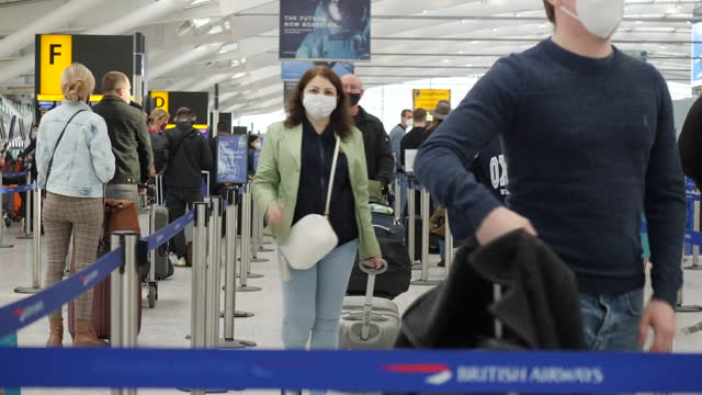 interior shots of passengers in london heathrow terminal 5 at british airways check in desks in a queue with luggage on 17 may 2021 in london, united... - travel stock videos & royalty-free footage