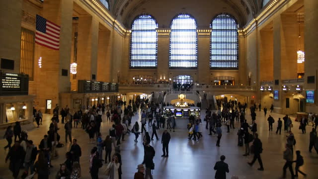 interior shots of passengers walking through grand central station and close up shots of the infamous clock and a us flag hanging on october 25, 2016... - infamous stock videos & royalty-free footage