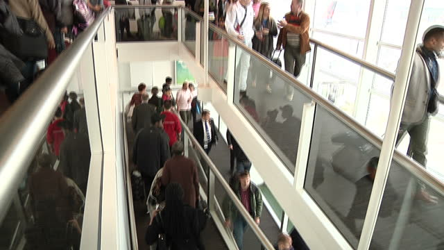 interior shots of passengers walking through the airort towards the exit, after explosions were heard in the airport on march 22, 2016 in brussels,... - terrorismus stock-videos und b-roll-filmmaterial