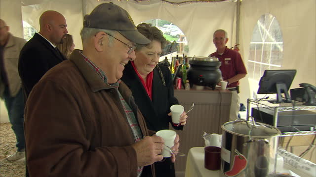 interior shots of people at a chilli contest trying various types of chill con carne in a marquee on the eve of the 2012 us presidential elections on... - chilli con carne video stock e b–roll