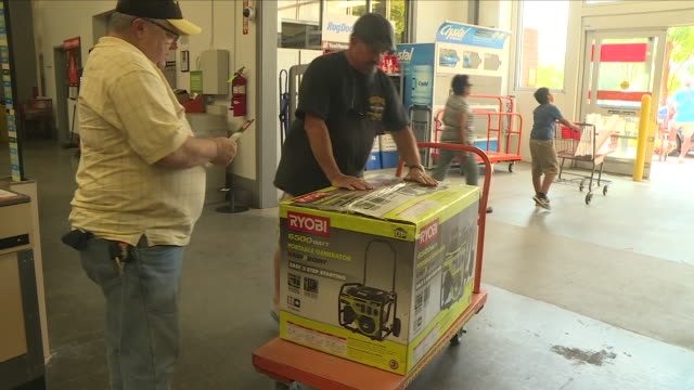 interior shots of people buying portable generators plywood and other supplies in a diy homewares store in preparation for hurricane florence on 11... - generator stock videos & royalty-free footage