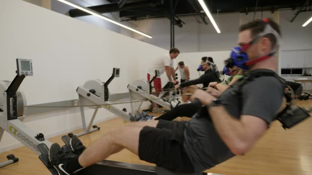 Interior shots of people exercising in Apple's Cupertino exercise lab testing Apple Watch and other fitness devices wearing masks on 13 March 2019 in...