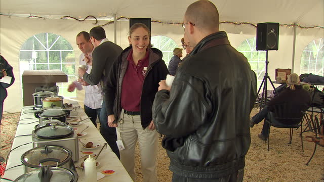 interior shots of people tasting different types of chilli con carne in a virginia chilli contest on the eve of the 2012 us presidential elections on... - chilli con carne video stock e b–roll