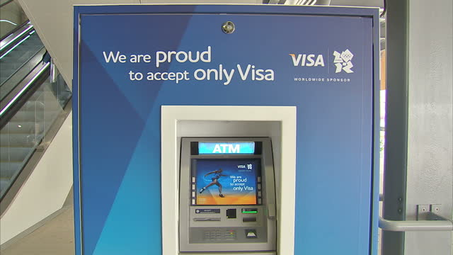 interior shots of people using olympic branded visa atm cash machine at the olympic site in stratford sky news 2012 olympics coverage at olympic... - ロンドン ストラトフォード点の映像素材/bロール