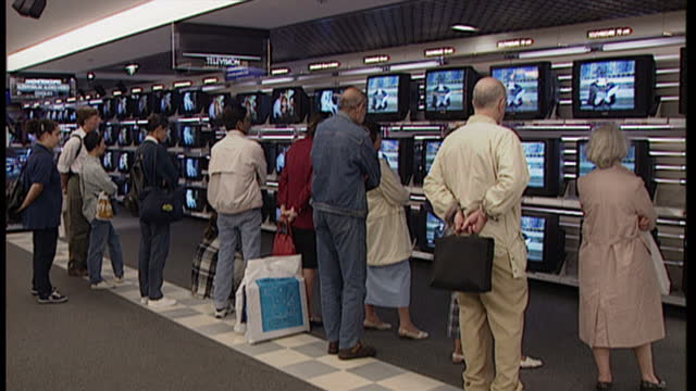 interior shots of people watching princess diana's funeral service on tv's on display at an electrical store on november 9 1997 in paris france - funeral stock videos & royalty-free footage