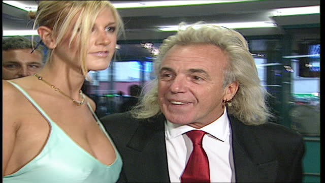interior shots of peter stringfellow arriving with his girlfriend for the gala screening of casablanca and posing for photographers including an... - humphrey bogart stock videos & royalty-free footage