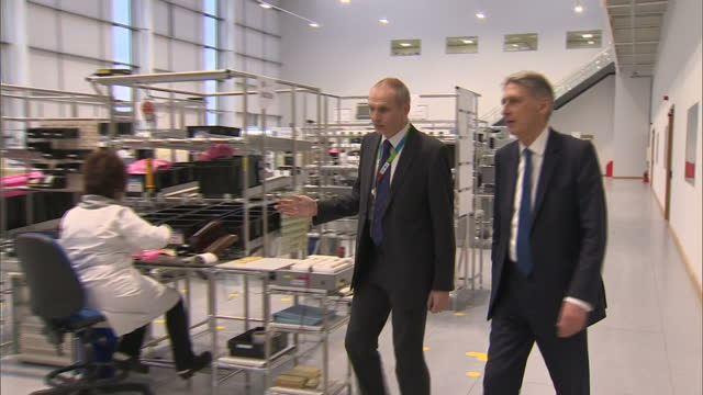 interior shots of philip hammond mp chancellor walking around talking to staff at general electric stafford on january 23 2017 in stafford england - general electric stock videos & royalty-free footage