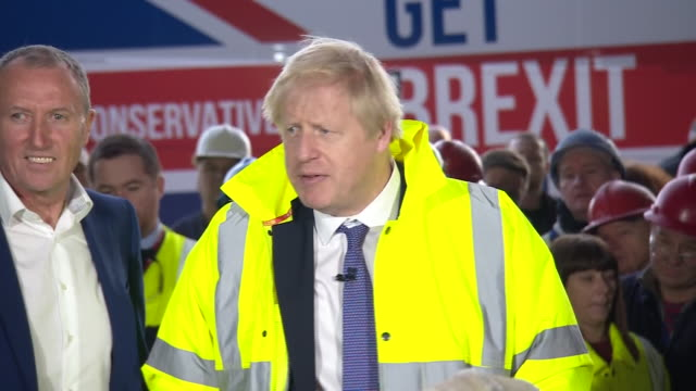 interior shots of pm boris johnson answering question if he can promise the nhs not being for sale during his visit to wilton engineering services on... - brexit stock-videos und b-roll-filmmaterial