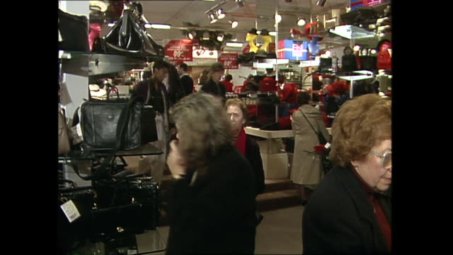interior shots of postchristmas sales shoppers in a department store buying bargains and paying at tills with cash and cheque on 28 december 1989 in... - oxford street stock-videos und b-roll-filmmaterial