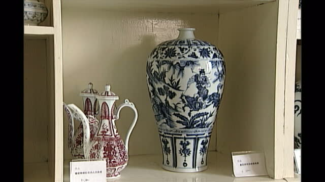 interior shots of pots on display and being moved around in porcelain factory on may 08, 1998 in jingdezhen, jiangxi province, china. - porcelain stock videos & royalty-free footage