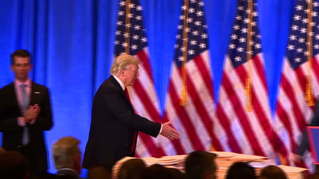 interior shots of president elect donald j trump walking to podium shaking hands with vice president elect mike pence to deliver a press conference... - lectern stock videos & royalty-free footage