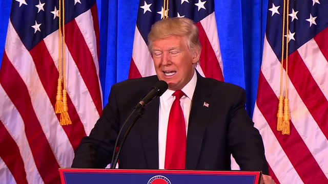 interior shots of president elect donald trump speaking at a podium during a press conference to refute claims of the existence of a russian dossier... - president trump stock videos and b-roll footage