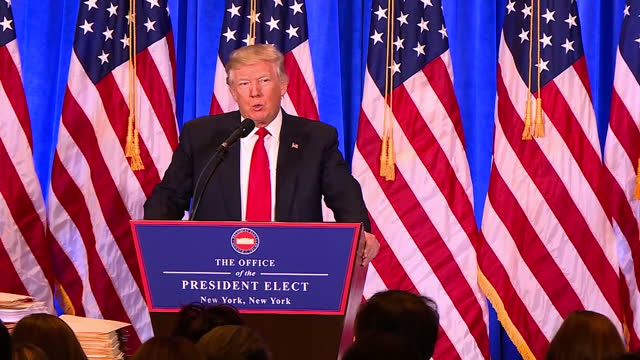 interior shots of president elect donald trump speaking at a podium during a press conference to refute claims of the existence of a russian dossier,... - pressekonferenz stock-videos und b-roll-filmmaterial