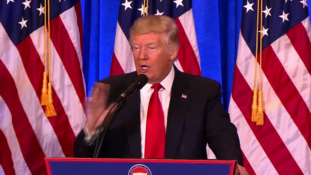 interior shots of president elect donald trump speaking at a podium during a press conference to refute claims of the existence of a russian dossier... - lectern stock videos & royalty-free footage