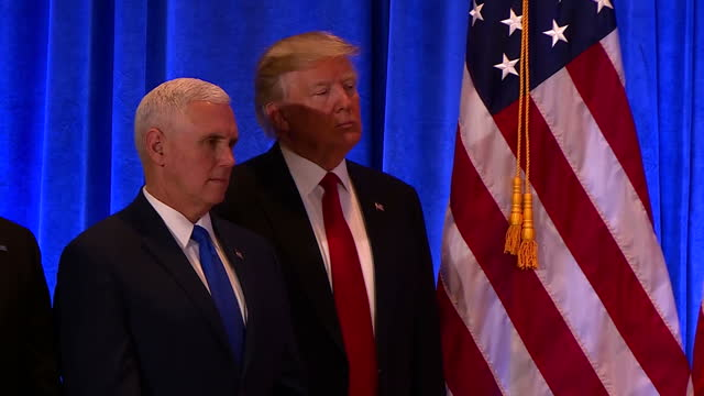 Interior shots of President Elect Donald Trump stood on stage next to Vice President Elect Mike Pence son Donald Trump Jr and daughter Ivanka Trump...