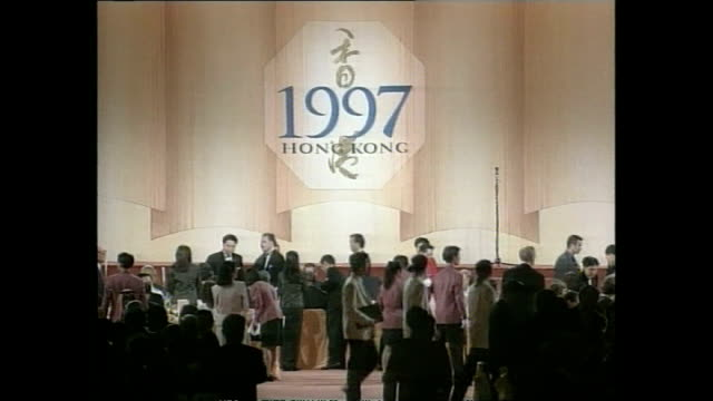 interior shots of president jiang zemin, tony blair, chris patten and prince charles entering room to applause for a celebratory banquet on the... - colonial stock videos & royalty-free footage