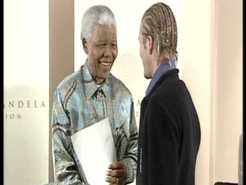 Interior shots of President Mandela shaking hands with members of the England Football team as they enter the room incl David Beckham General shots...