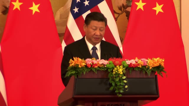 Interior shots of President Xi Jinping speaking during a joint press conference with President Donald Trump with cutaway shots to members of the...