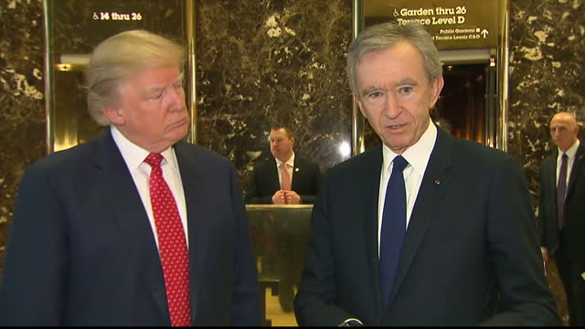 Interior shots of Presidentelect Donald Trump and CEO of LVMH Bernard Arnault speaking to press about expanding LVMH in the USA at Trump Tower on...