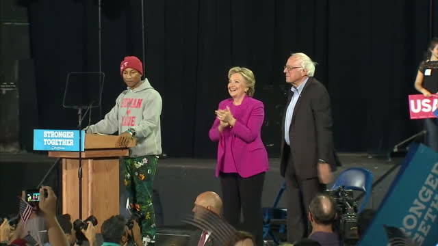 vídeos de stock, filmes e b-roll de interior shots of presidential candidate hillary clinton walking onto stage with bernie sanders during a campaign event in pennsylvania on november... - bernie sanders