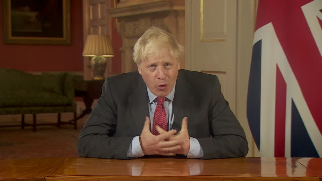 stockvideo's en b-roll-footage met interior shots of prime minister, boris johnson address to the nation as he introduces further lockdown restrictions as covid-19 cases continue to... - aankondigingsbericht