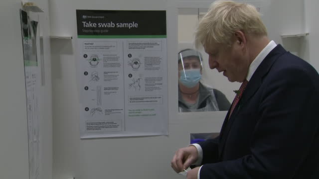 interior shots of prime minister boris johnson at a mass coronavirus testing centre doing a diy throat swab under instruction in a booth on 6... - diy stock videos & royalty-free footage