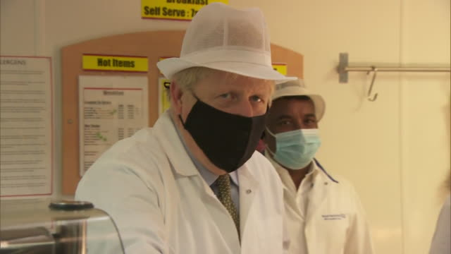 interior shots of prime minister boris johnson on a visit to the royal berkshire hospital with prue leith, meeting chefs, as the government launches... - prudence leith stock videos & royalty-free footage