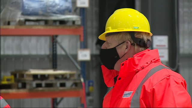 interior shots of prime minister boris johnson on a visit to the wind turbine engineering company catapult, wearing a hard hat and high visibility... - construction industry stock videos & royalty-free footage