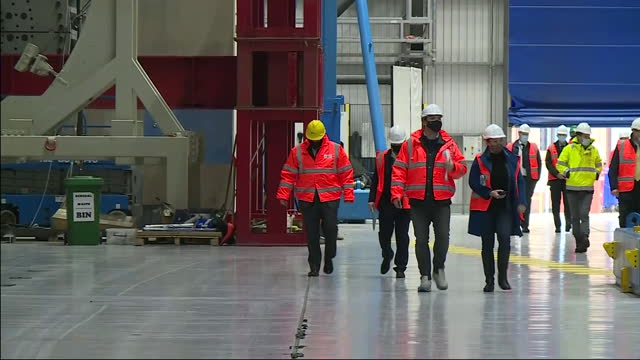interior shots of prime minister boris johnson on a visit to the wind turbine engineering company catapult, wearing a hard hat and high visibility... - wind turbine stock videos & royalty-free footage