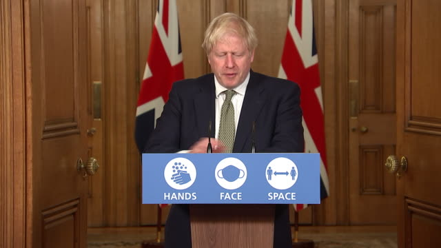 interior shots of prime minister boris johnson speaking at a government press briefing, announcing new 'three tier' system for coronavirus lockdown... - order stock videos & royalty-free footage