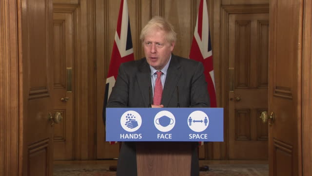 stockvideo's en b-roll-footage met interior shots of prime minister boris johnson speaking during a government press briefing on coronavirus on the 30th september 2020 in london,... - clean