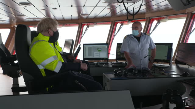 interior shots of prime minister boris johnson with crew members on the bridge of the ship 'alba' on an inspection of an offshore wind farm on 5... - examining stock videos & royalty-free footage
