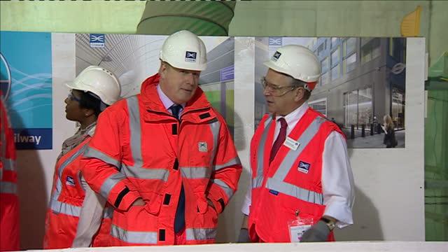 interior shots of prime minister david cameron and boris johnson mayor of london visiting crossrail tunnels at an event marking the halfway point of... - クロスレール路線点の映像素材/bロール